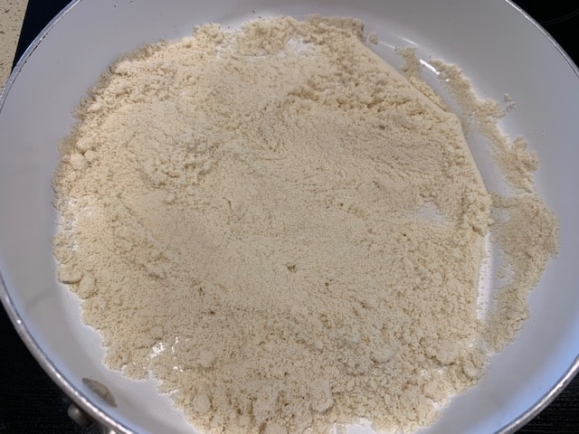 Tasting Almond flour in a pan
