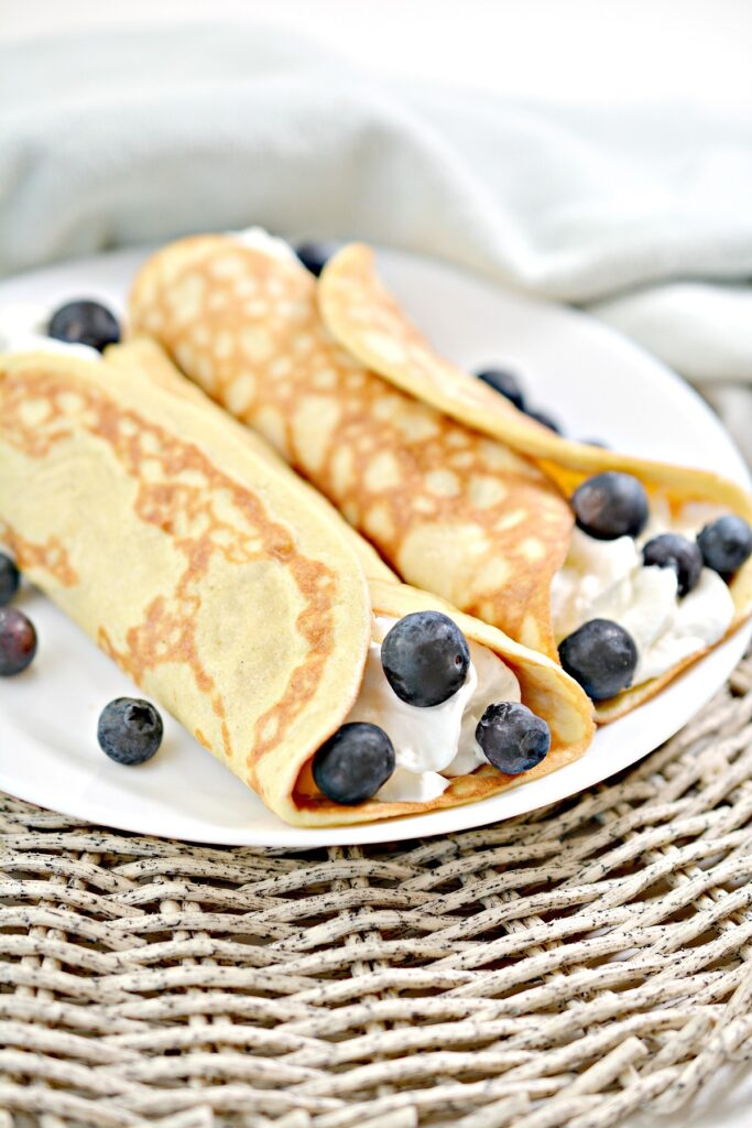 Keto Crepes on plate with blueberries